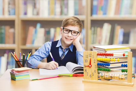 School Kid Education, Student Boy Studying Books, Little Child in Glasses, Abacus clock Stock Photo