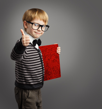 Kid in Glasses, Child Advertiser with Certificate Book, School Boy Showing Thumb Up, Certification Education Stockfoto