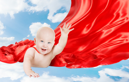 fly: Baby Superhero, Kid Super Hero with red cape, Child Boy Flying in Blue Sky