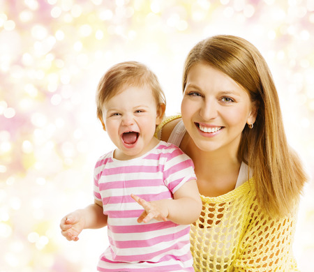 mother baby: Mother and Baby Girl Family Portrait, Smiling Woman with Happy Laughing Kid, Daughter one year old Stock Photo