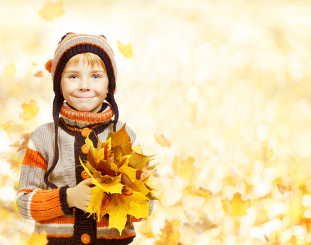 boy beautiful: Kid Autumn Fashion Season, Child in Hat Jacket Clothing, Boy with Fall Leaves Looking at camera, six years old Stock Photo