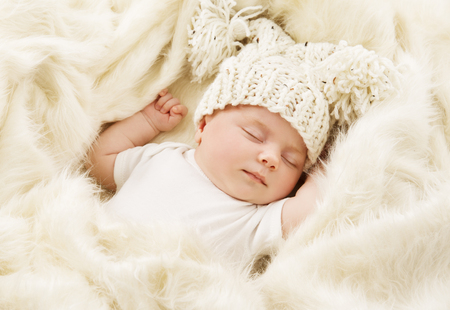 girl face close up: Baby Sleeping in Bed, Newborn Kid Sleep in Hat, New Born One Month Girl