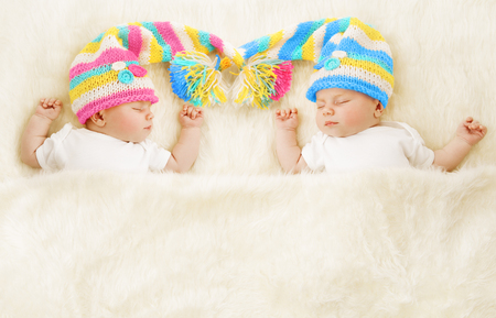 Twins Babies Sleep in Hat, Newborn Kids Sleeping, Cute New Born Girl and Boy