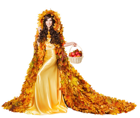 Autumn Woman in Fall Leaves Cape with Apples, Model Girl in Fashion Yellow Dress, isolated on White Background photo