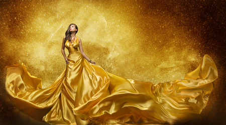 female pose: Gold Fashion Model Dress, Woman In Golden Silk Gown Flowing Fabric, Beautiful Girl on Stars Sky looking up