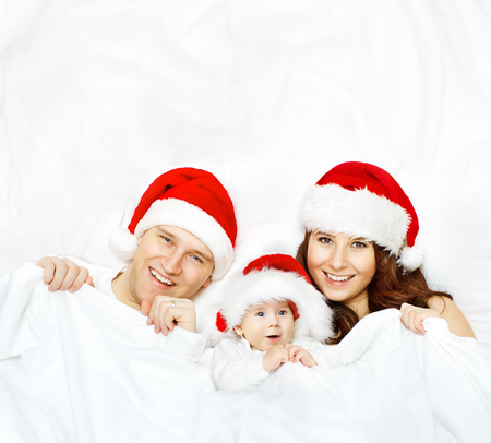 christmas fun: Family in Christmas Hat, Baby and Mother Father, Kid on White Background