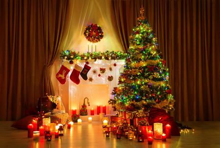 decorated christmas tree: Christmas Tree in Room, Xmas Home Night Interior, Fireplace Lights Decoration, Hanging Socks Stock Photo