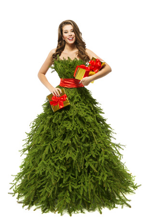 green clothes: Woman Christmas Tree Dress, Fashion Model Girl and Xmas Present Gifts, Green Clothes on White