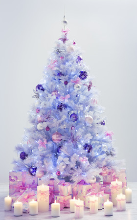 fairy tree: Christmas Tree and Presents, Decorated Xmas Tree Candles Gifts on Blue Background with Decorative Balls