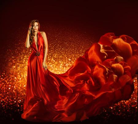 Moda mujer de vestido rojo, Belleza Modelo vestido de tela de seda del vuelo, Chica elegante con paño que fluye