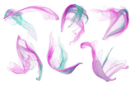 mosca: Paño de la tela, seda del vuelo que agita en blanco, rosado Cian piezas de ropa Foto de archivo