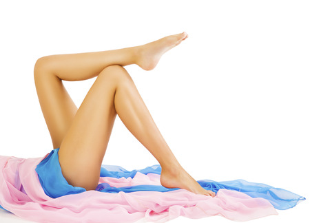 Woman Legs Beauty, Body Skin Care, Model Lying on White Stock Photo