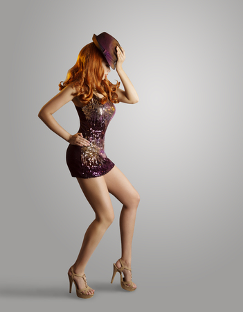 sexy fashion: Dancing Girl, Woman Artist Dance in Hat Sparkling Dress on Gray Stock Photo