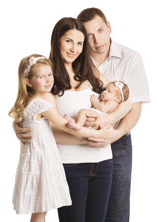 young boy smiling: Family Portrait Four Persons, Mother Father and Kids Baby Daughters Stock Photo