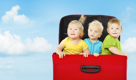 baby sit: Kids in Suitcase, Three Happy Children Playing and Looking Up