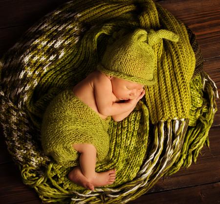 Baby Newborn Sleep on Green Wool, Sleeping New Born Kid Stock Photo
