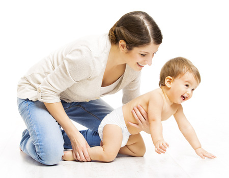 Mother and Crawling Toddler Kid, Woman Parent Holding Child in Diaper Over White Foto de archivo