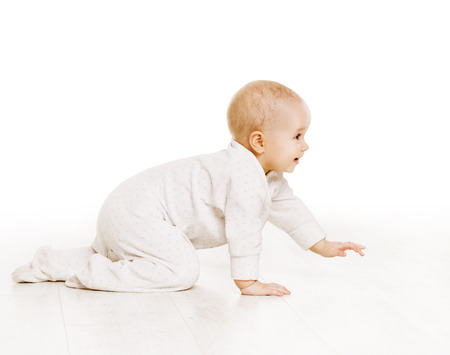 Toddler Crawling in White Baby Onesie, Active Kid Creeping over White Background Stock Photo