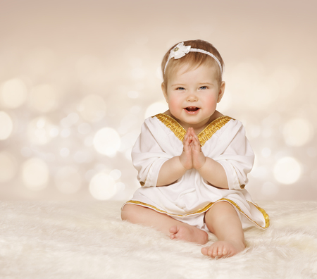 one: Baby Ancient Dress, Kid Girl in White Clothes Folded Hands, One Year Old Stock Photo