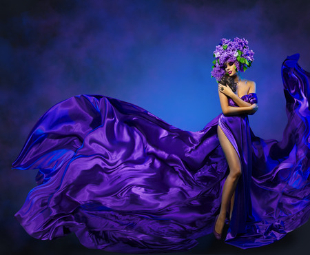 Woman Flower Dress Flying Fabric, Beauty Fashion Model Dancing in Lilac Crown