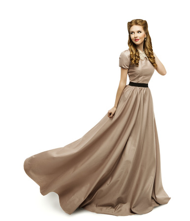 historical periods: Woman Brown Dress, Fashion Model in Long Gown Turning on White