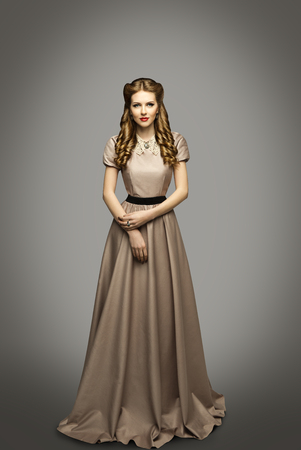 historical periods: Woman Long Dress, Fashion Model in Historical Gown over Gray