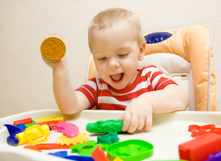 Baby Molding Clay, Artistic Little Kid Playing Colorful Plasticine photo