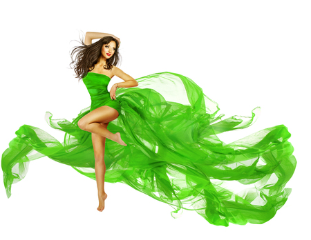 DAnce background: Woman Dancing in Green Dress, Dancer Fashion Model with Flying Silk Fabric over White Stock Photo