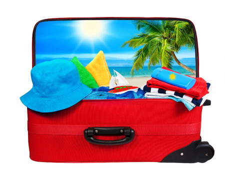over packed: Luggage Packed to Vacation, Travel Suitcase Open Bag Isolated Over White Stock Photo