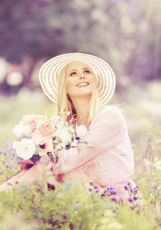 dress up: Woman Hat with Flowers Bouquet, Fashion Model looking up in Summer Park