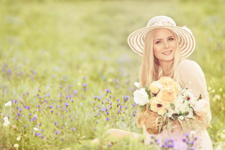 flowers garden: Woman in Hat with Flowers Bouquet, Fashion Model in Green Summer Field
