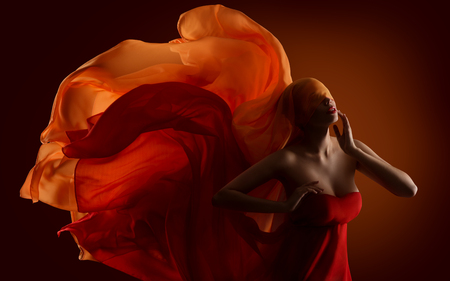 fabric painting: Fashion Woman Fabric on Face, Dance Silk Cloth Waving On Wind Stock Photo