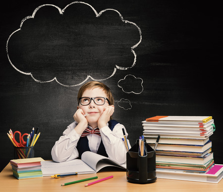 Kids Education, Child Boy Study in School, Thinking or Dreaming over Bubble on Chalkboard 写真素材