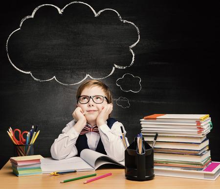 Kids Education, Child Boy Study in School, Thinking or Dreaming over Bubble on Chalkboard Standard-Bild