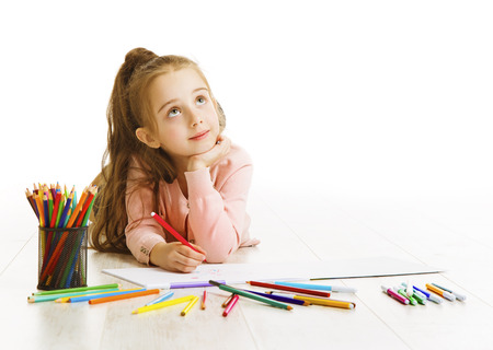 Child Education Concept, Kid Girl Drawing and Dreaming School, Lying down on White Standard-Bild