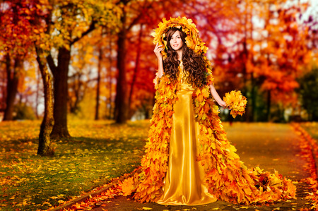 Autumn Woman Fall Leaves Dress Walking In Fairyland Forest, Fashion Girl in Yellow Gown