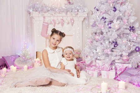 elegant girl: Christmas Children, Kid and Baby Girls with Present Gift, Decorated Pink Room Xmas Tree