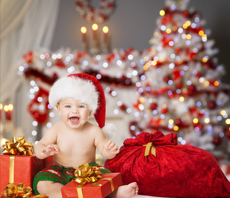Christmas Baby in Santa Hat, Kid Boy with Xmas Present Gift Box and Bag
