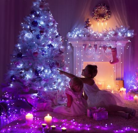 fire place: Kids Celebrating Christmas, Child and Baby, Decorated Xmas Tree, Fire Place Lights in Night Room Interior
