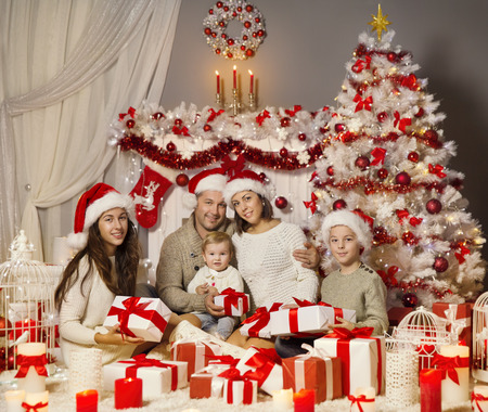 celebrate year: Christmas Family Portrait, Holiday Xmas Tree and Presents Gifts Boxes, Happy Parents and Children
