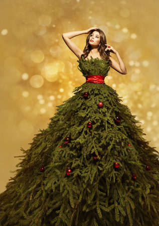 clothing model: Fashion Model Christmas Tree Dress, Woman Xmas Gown, New Year Clothing Decoration Stock Photo
