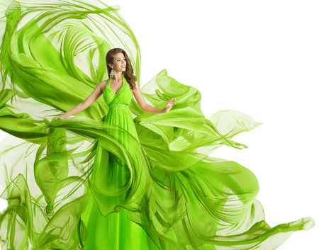 Fashion Woman Flying Dress, Model in Green Gown Waving Chiffon Fabric, Flowing Cloth Isolated over White Foto de archivo