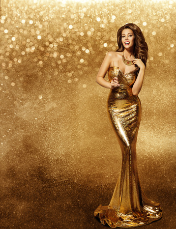 Woman Gold Dress, Fashion Model with Champagne in Long Golden Gown, Vip Girl Celebrating Holiday over Sparkles background