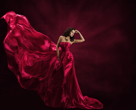 Fashion Model Dress, Woman in Flying Gown, Silk Fabric Waving on Wind, Satin Cloth Flowing Waves photo