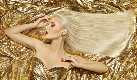 Gold Fashion Hair Style, Blonde Woman Hairstyle, Golden Long Straight Hair on Luxury Color background Stock Photo