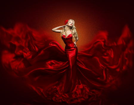 Woman Fashion Dress, Red Art Gown Flying Silk Fabric, Elegant Girl in Fashions Waving Cloth photo