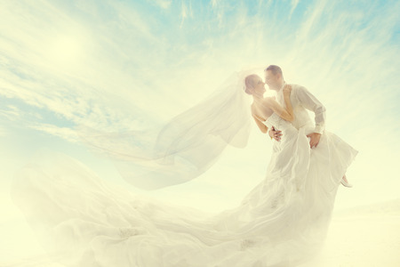 Bride and Groom Couple Dancing, Wedding Dress and Long Veil photo