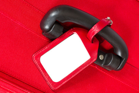 leather belt: Suitcase Tag, Empty Travel Luggage Label on Handle, Red Baggage Bag Closeup Stock Photo