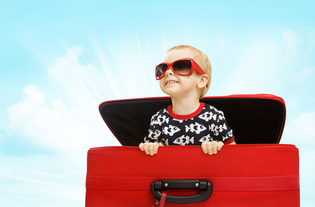 Kid inside Suitcase, Child Looking out Travel Luggage, Happy Baby Boy in Sunglasses