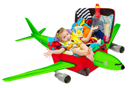 Kid Travel in Suitcase Airplane, Child inside Luggage Plane Flying to Vacation, Isolated over White Background photo